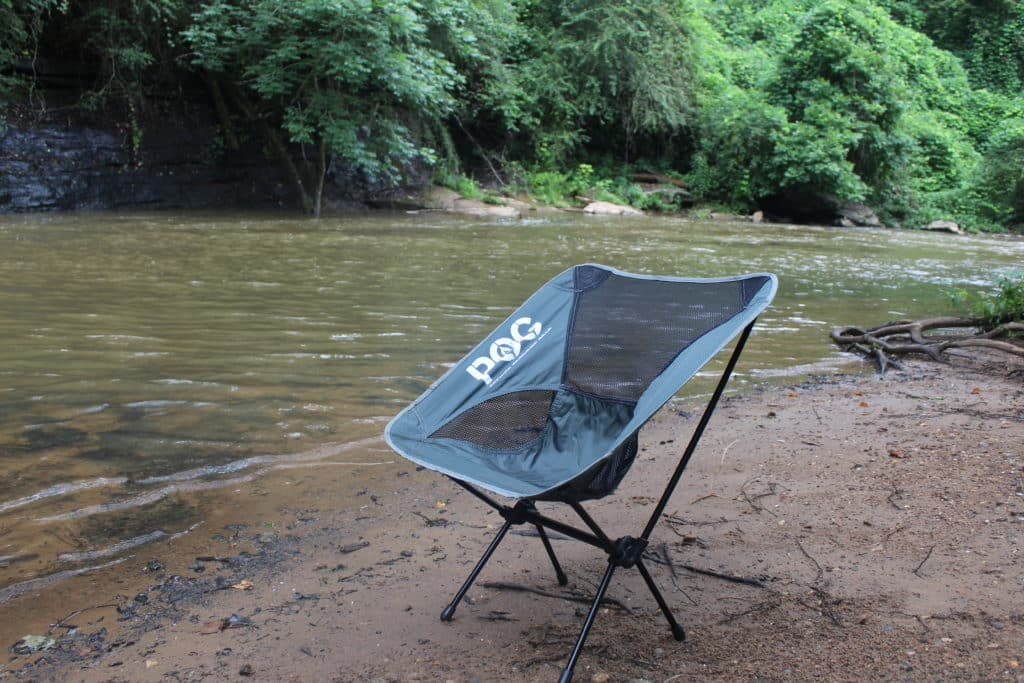 Blue POG Springer Lightweight Camping Chair on the Beach by a River