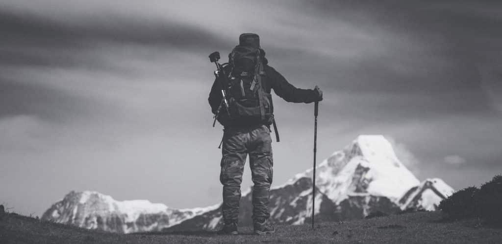 man using shock absorbing hiking poles
